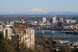 Downtown Portland and the Willamette River, with Mt St Helens in the background.
