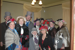 The Gloriana Carolers raise money for a music scholarship fund.